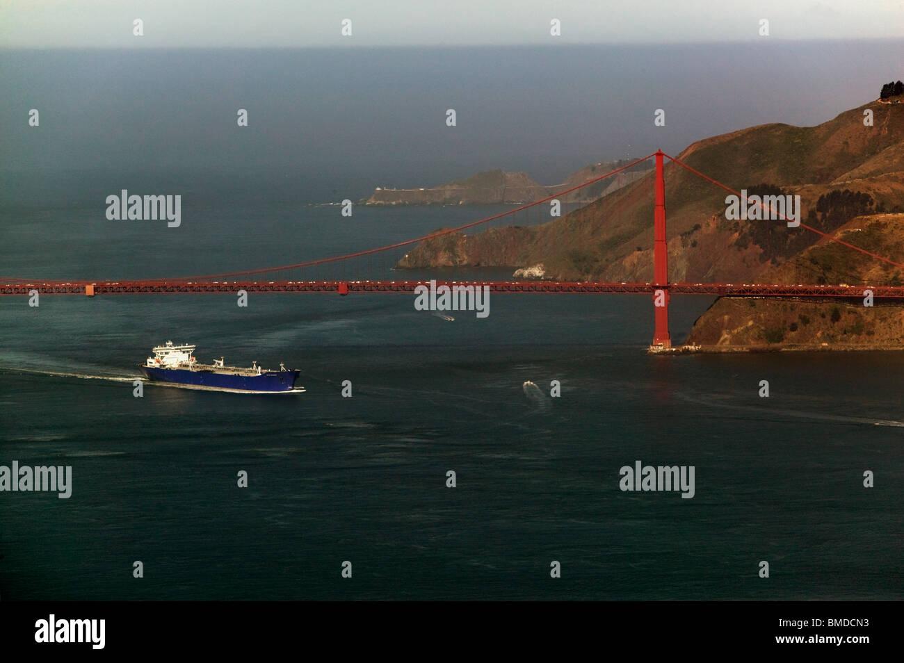 aerial view above petroleum tanker entering San Francisco Bay Golden Gate Bridge - Stock Image