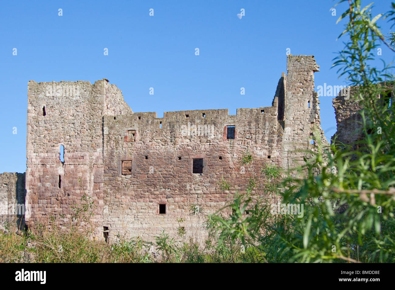 Hailes Castle in East Lothian in late afternoon sunshine. The moon in the sky, and taken from the less obvious north - Stock Image