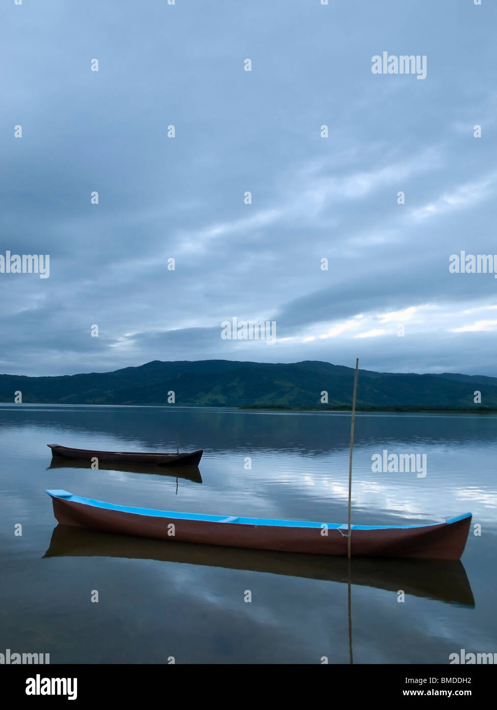 Tow boats at a lagoon at the early morning. - Stock Image