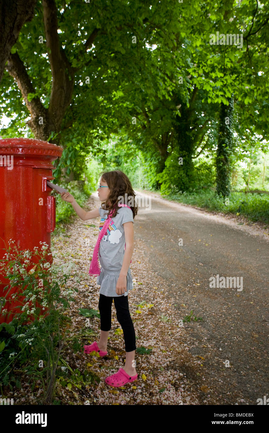 Young Girl Posting a Letter - Stock Image