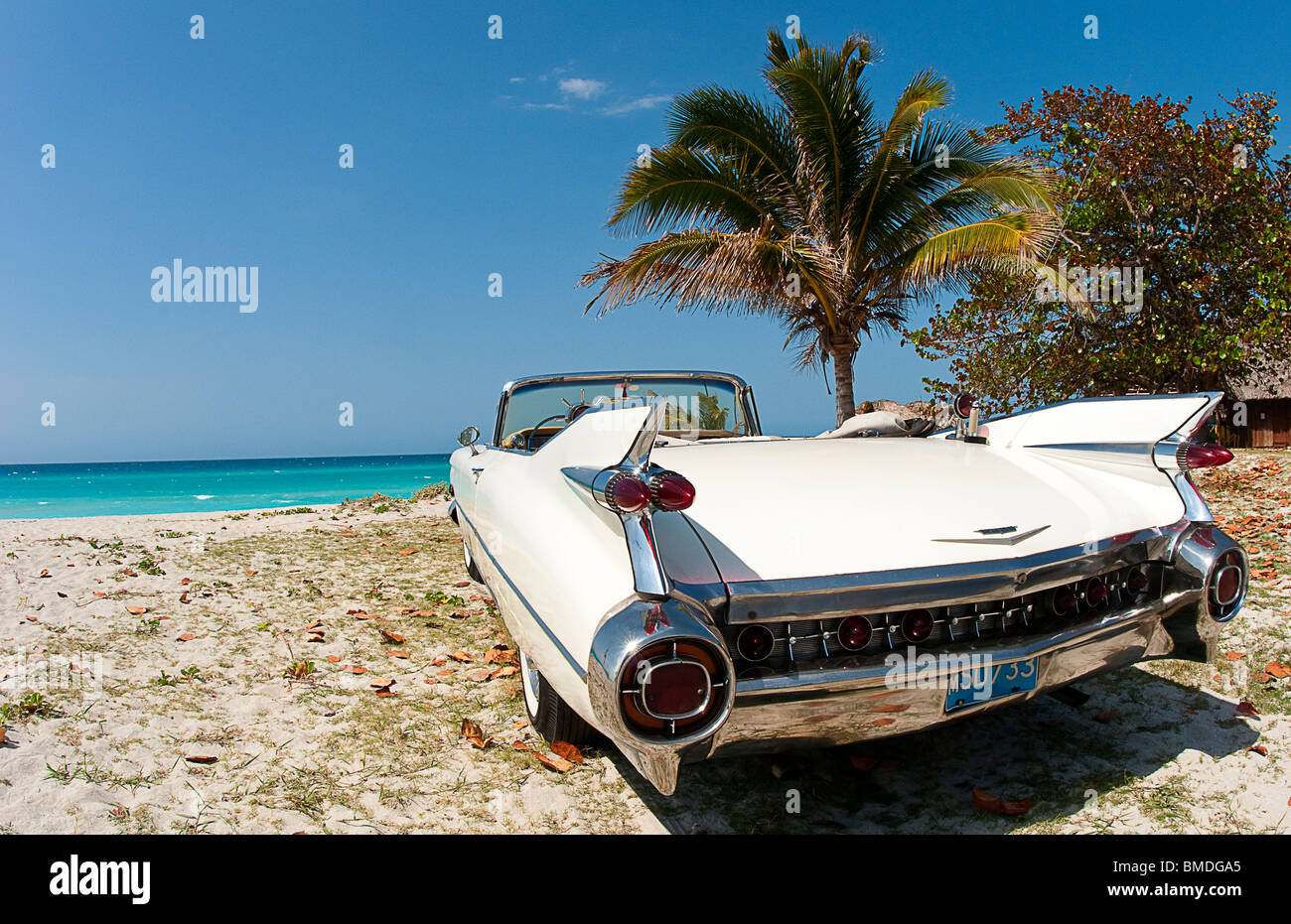 Classic 1959 White Cadillac Auto On Beautiful Beach Of Varadero Cuba