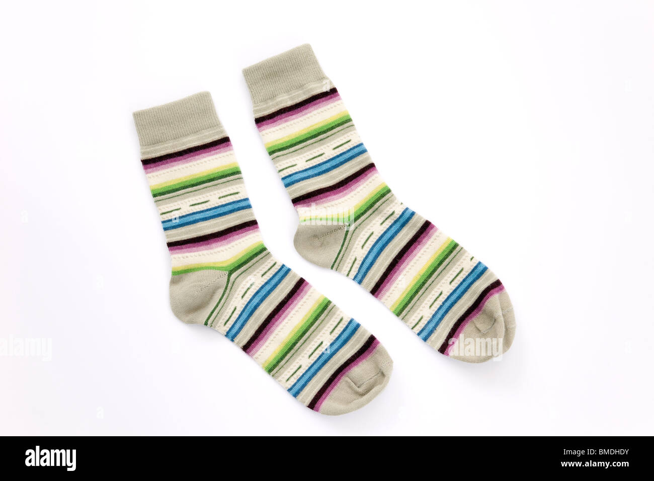 Matching pair of striped woollen socks on a white background - Stock Image
