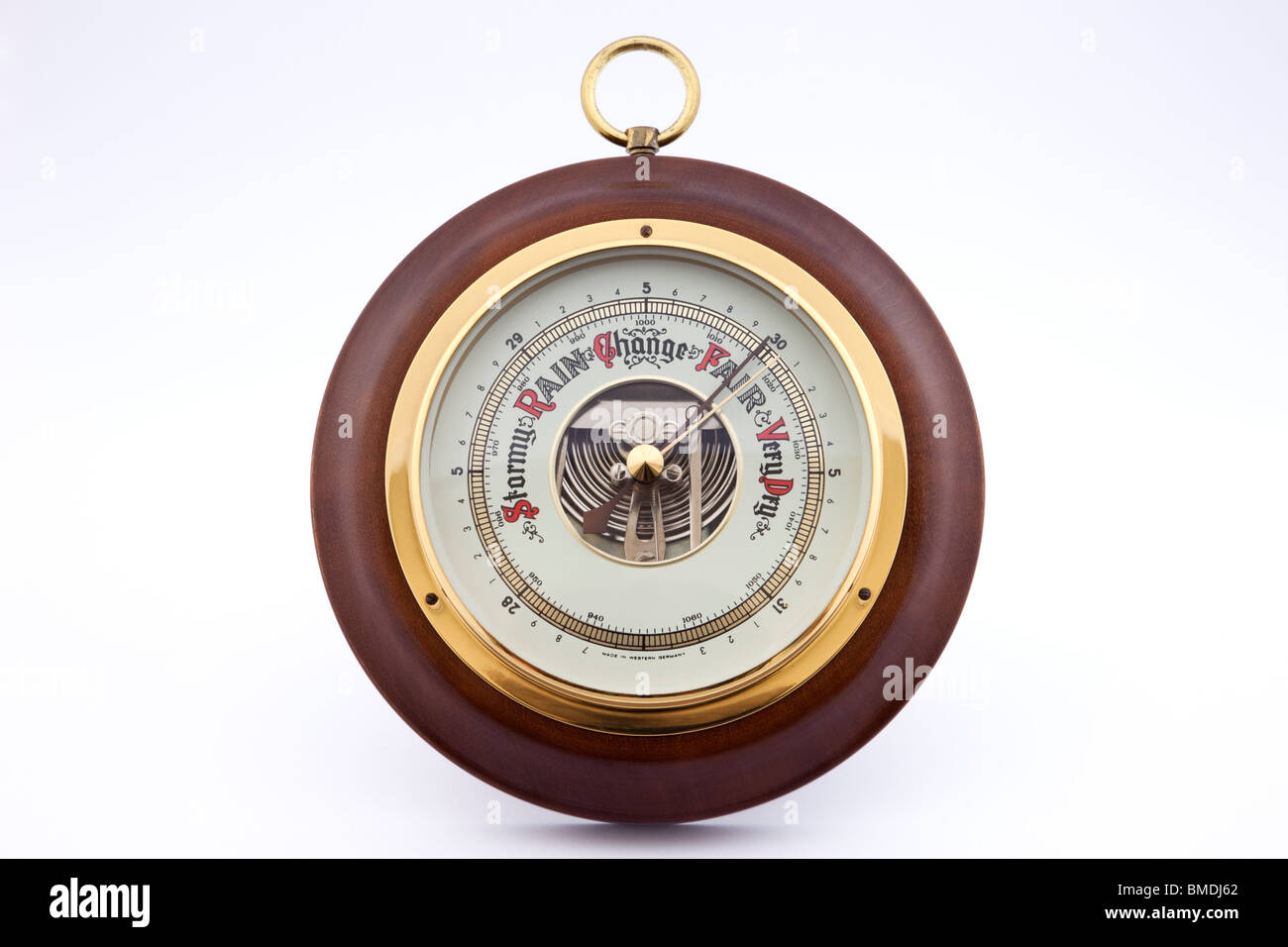 Classic aneroid barometer in brass and wood on plain white. Made in Germany by a German manufacturer. England UK - Stock Image