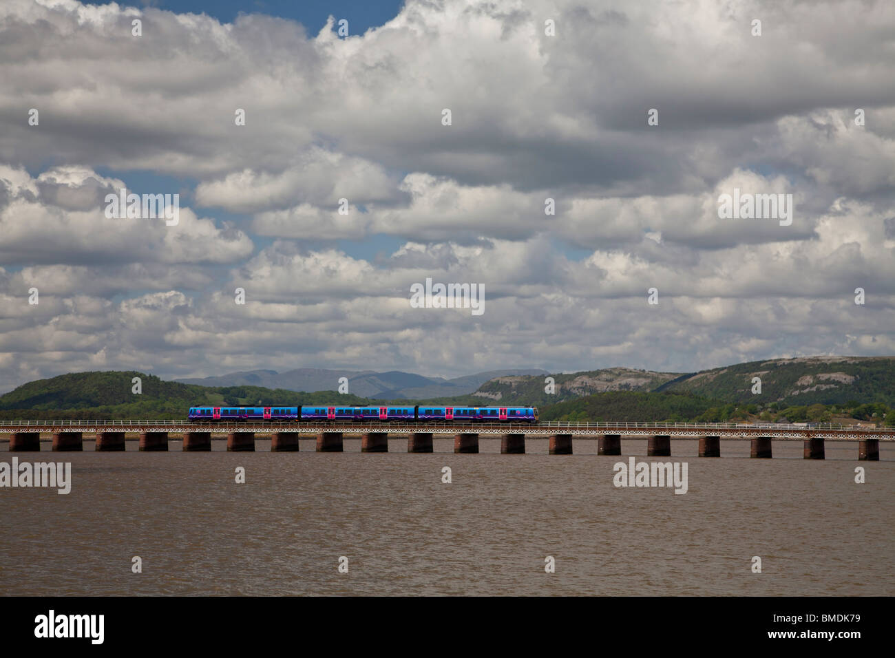 Barrow to Manchester Airport Transpennine Express crossing the Arnside viaduct over the Kent estuary, Cumbria. - Stock Image