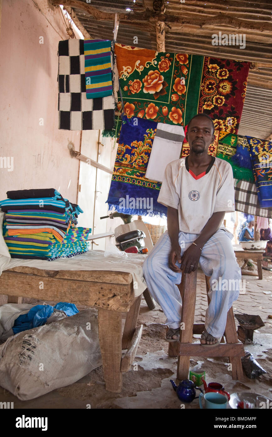 A Fulani man sells blankets and rugs in the marketplace in Segou, Mali. - Stock Image