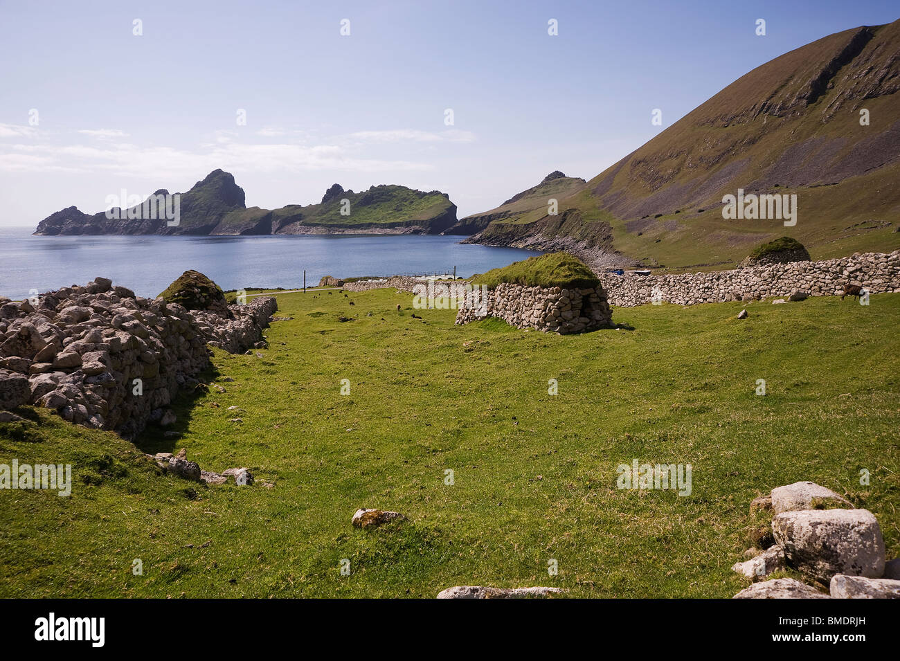 The view from one of the houses on St. Kilda, looking across the bay to Dun island - Stock Image