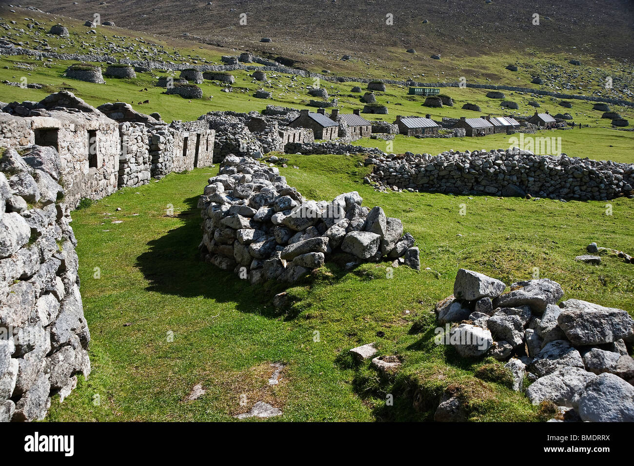Looking down the row of abandoned cottages in the main street of Village Bay on the island of St. Kilda - Stock Image