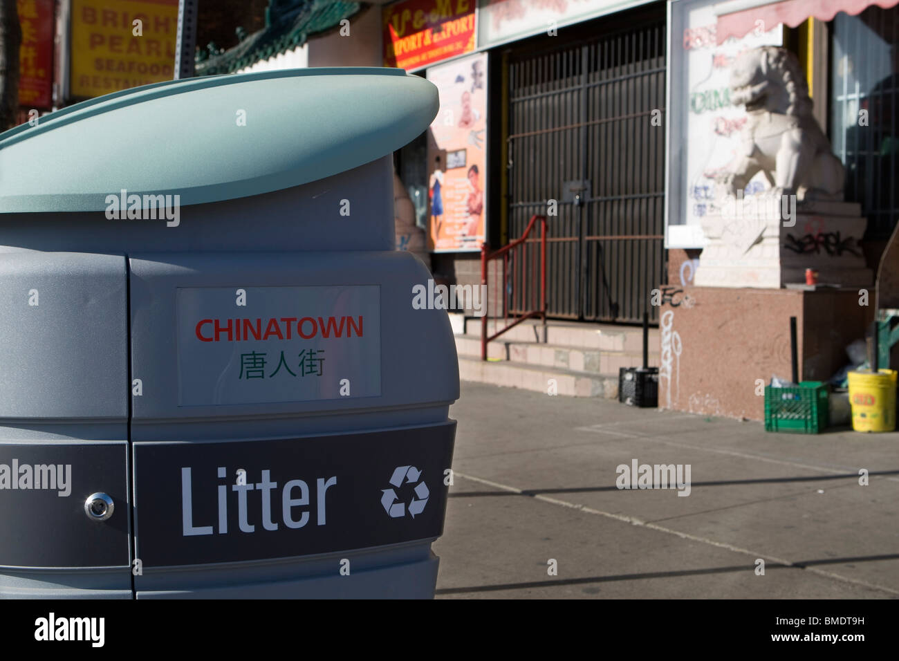 A trash can is seen in Toronto Chinatown - Stock Image
