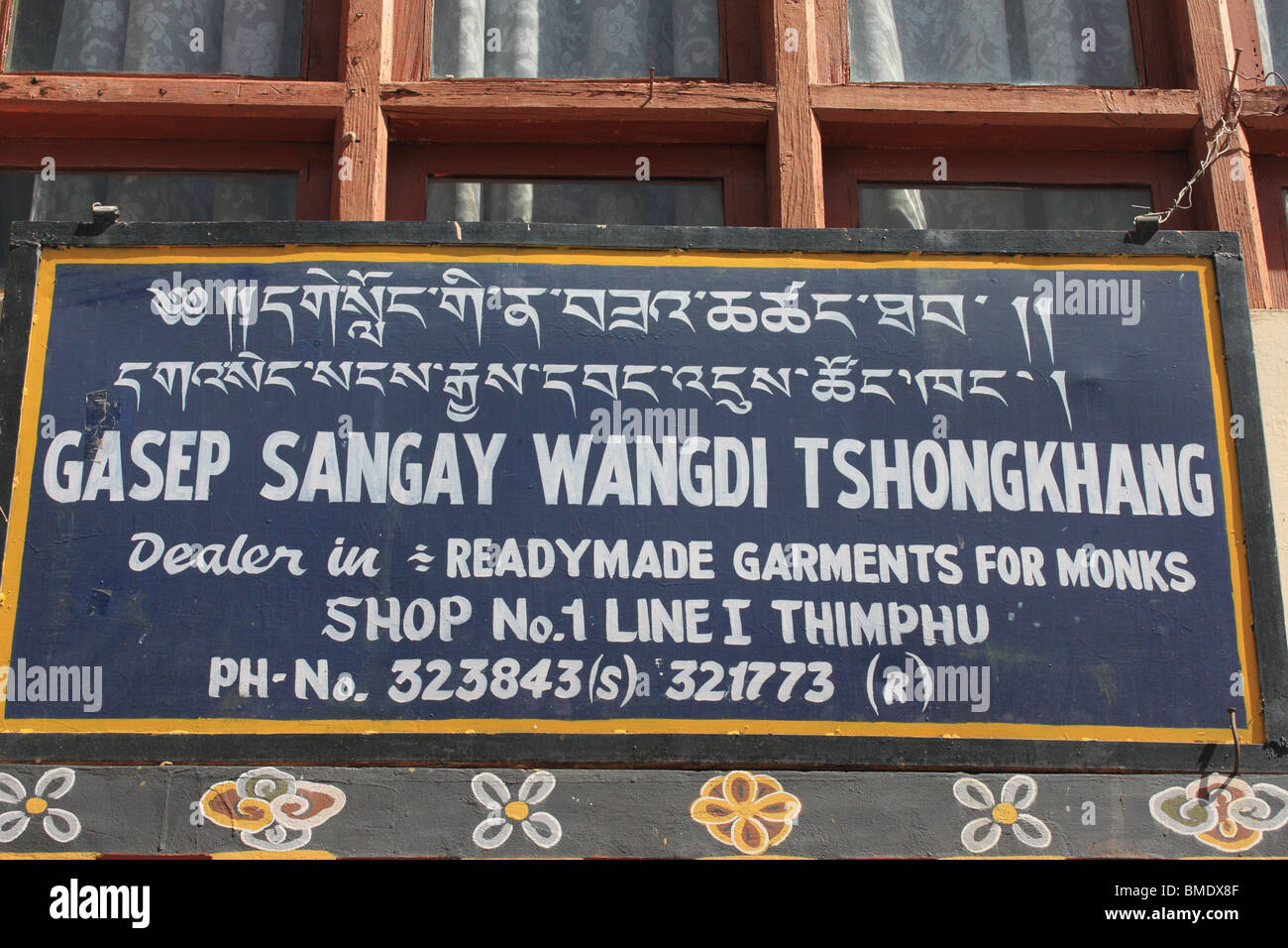 Sign for shop selling Ready made Garments for Monks, Thimphu, Bhutan - Stock Image