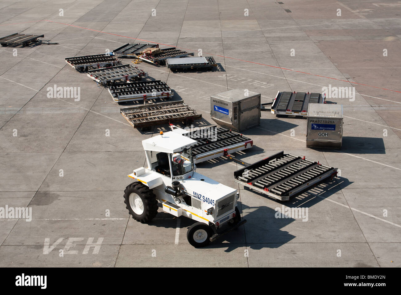 Baggage tractor, O.R. Tambo International Airport, formerly Johannesburg International Airport, South Africa - Stock Image