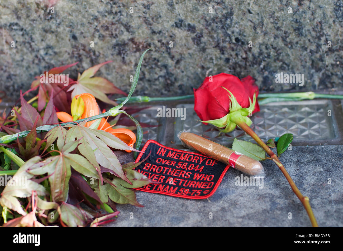 Mementos placed at the Washington State Vietnam Veterans Memorial wall in Olympia, Washington on Memorial Day. - Stock Image