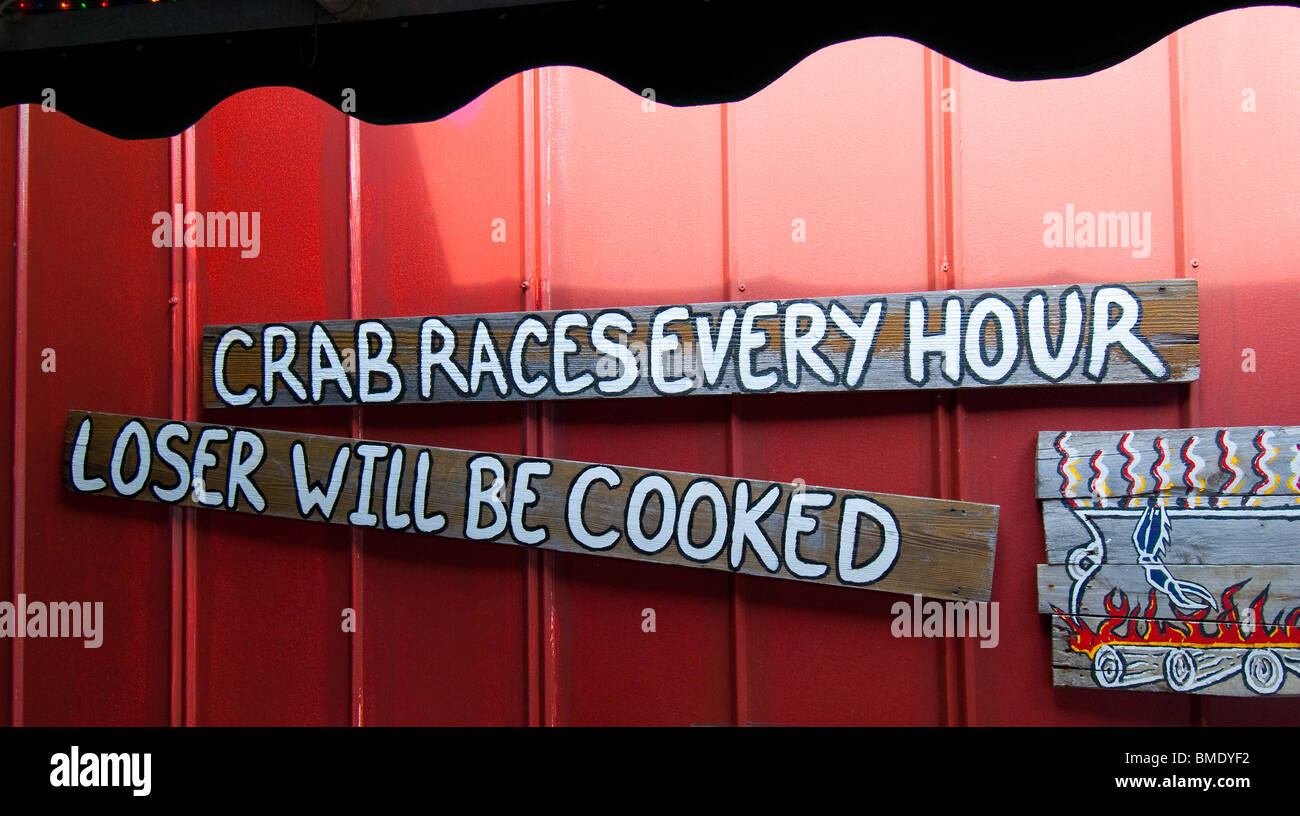 Humorous restaurant sign in historic Tin City, a waterfront marketplace in Naples, Florida, USA - Stock Image