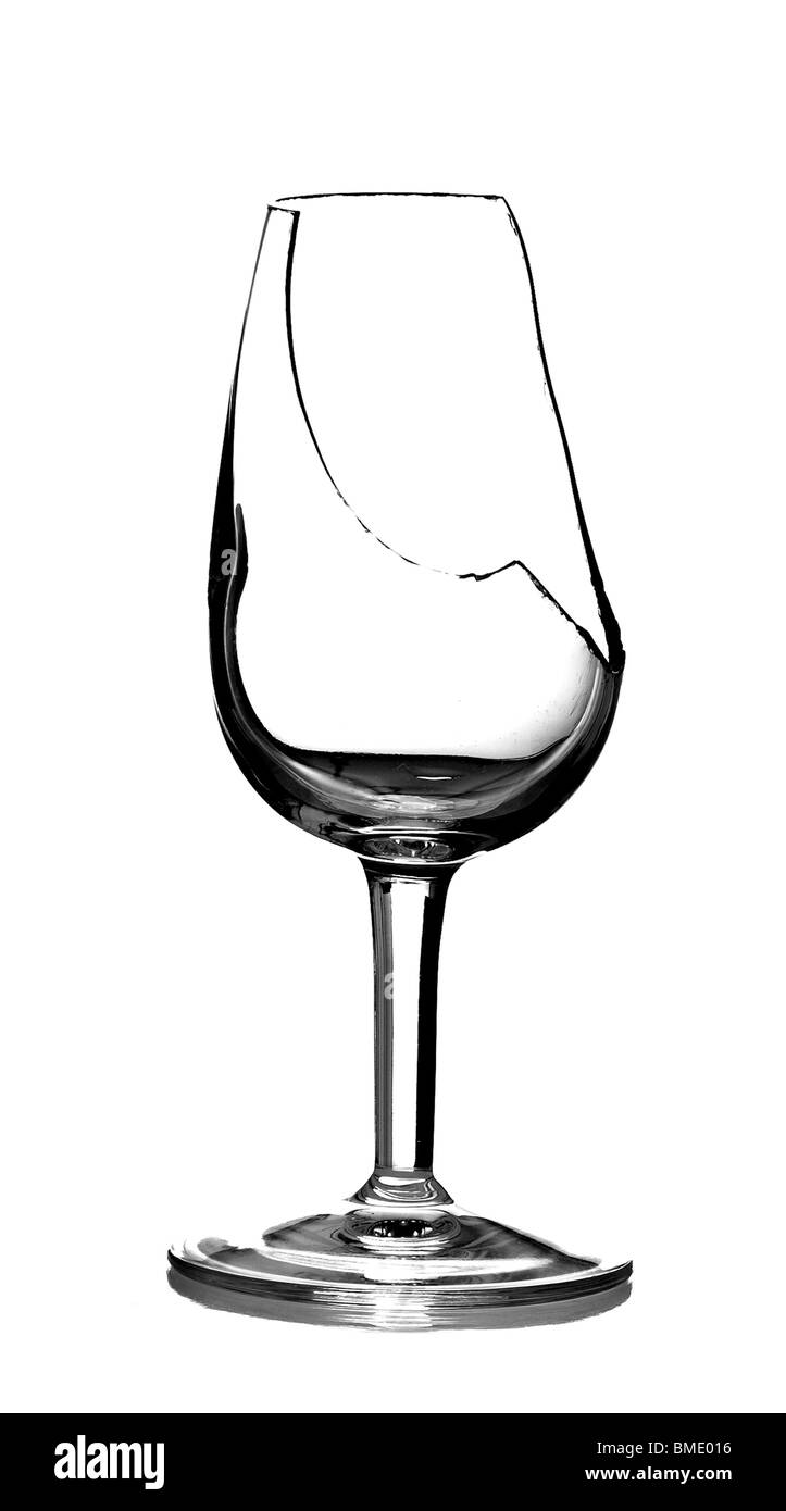 A broken sherry glass, isolated on a pure white background. - Stock Image