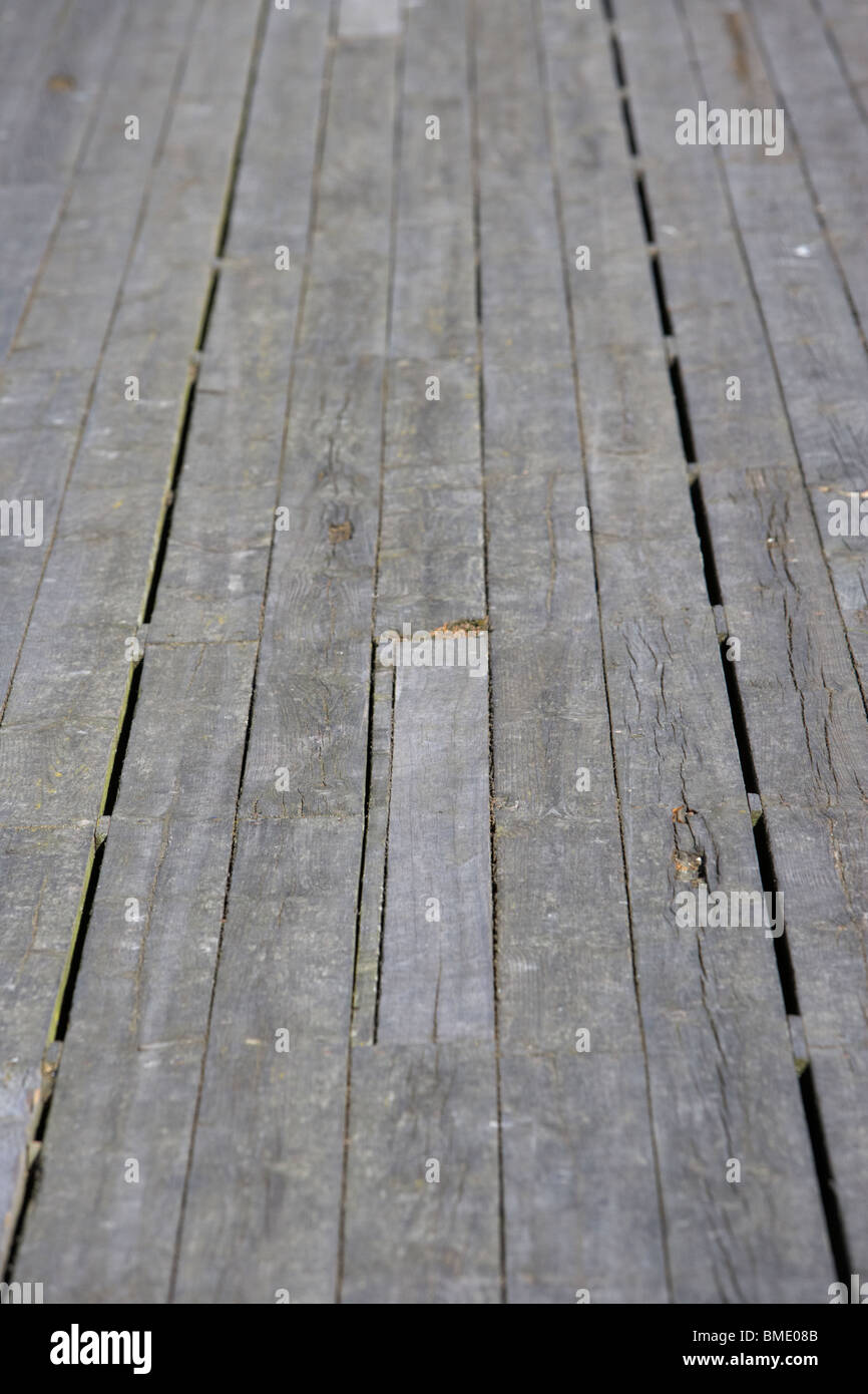 long wooden planks and repaired sections of an old victorian pier in the uk - Stock Image