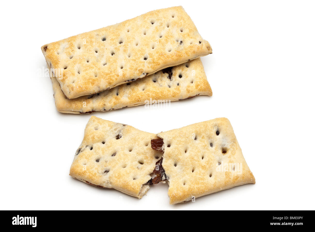 Three oblong shaped fruit filled crispy biscuits - Stock Image