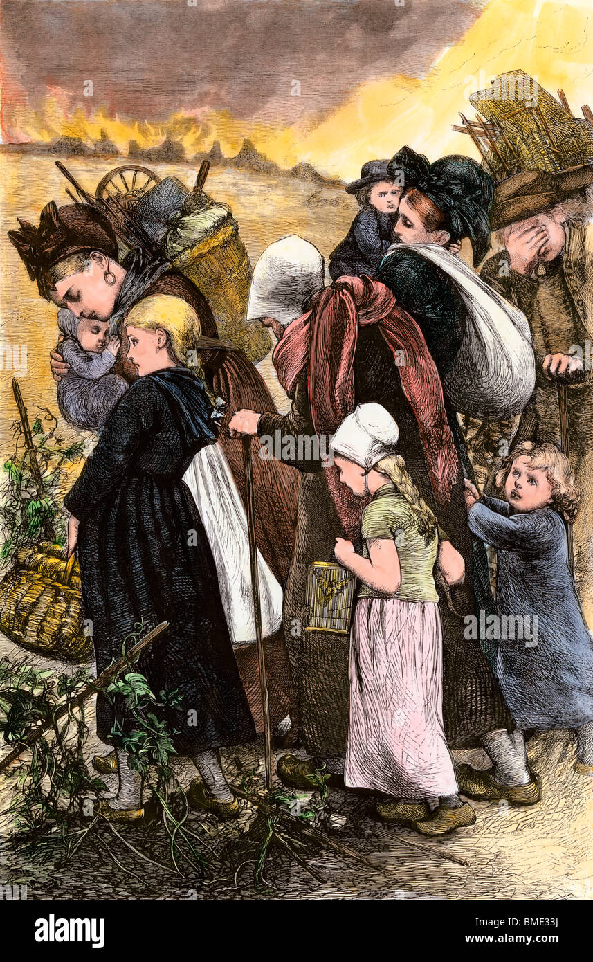 Flight of French peasants during the Franco-Prussian War, 1870. Hand-colored woodcut - Stock Image