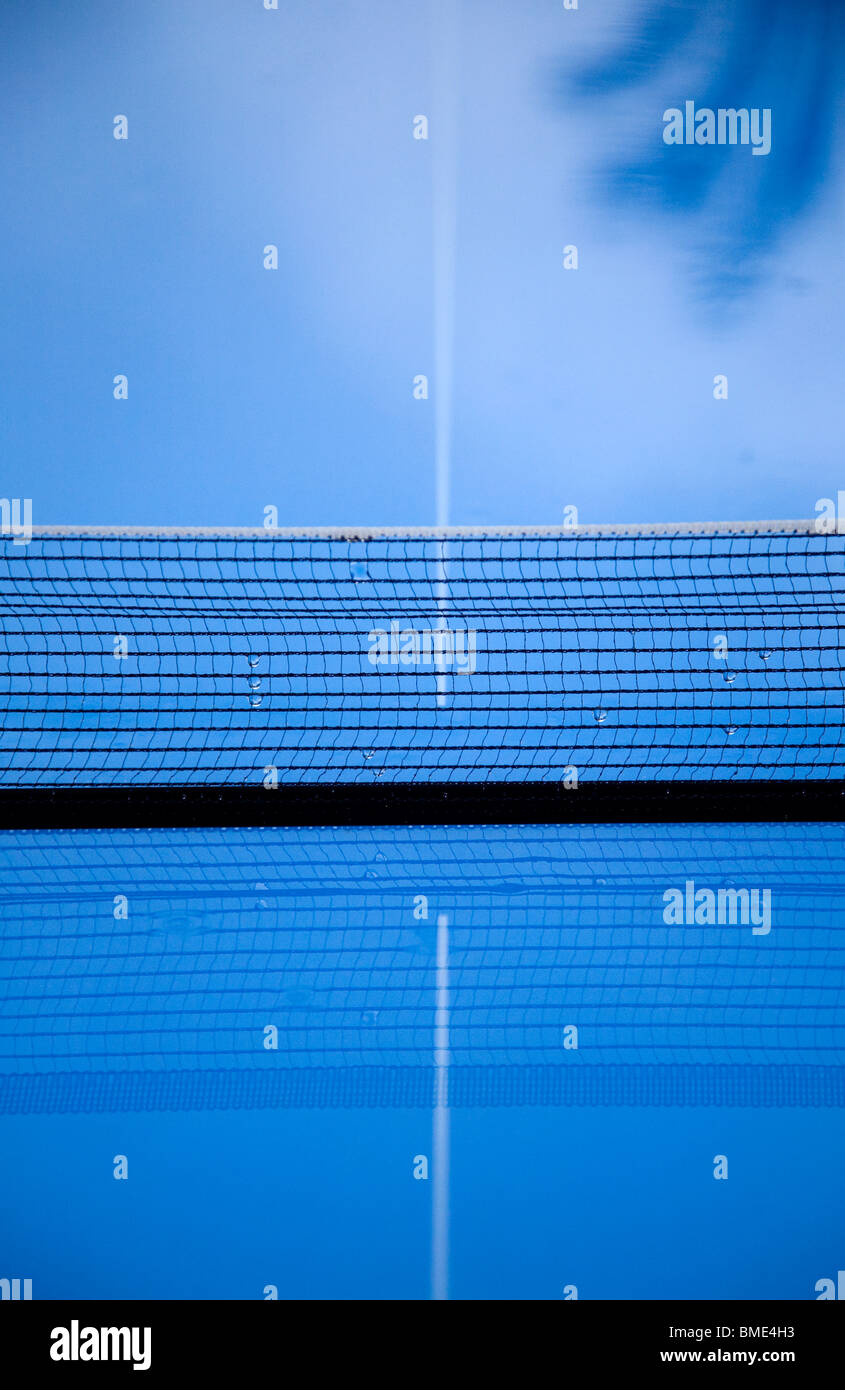 Blue table tennis table in rain - Stock Image