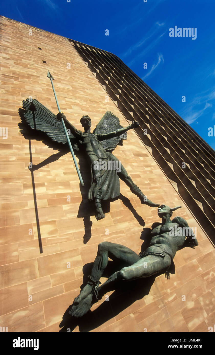 Sculpture of St Michael and the Devil on the wall of Coventry cathedral Warwickshire England UK GB EU England Stock Photo