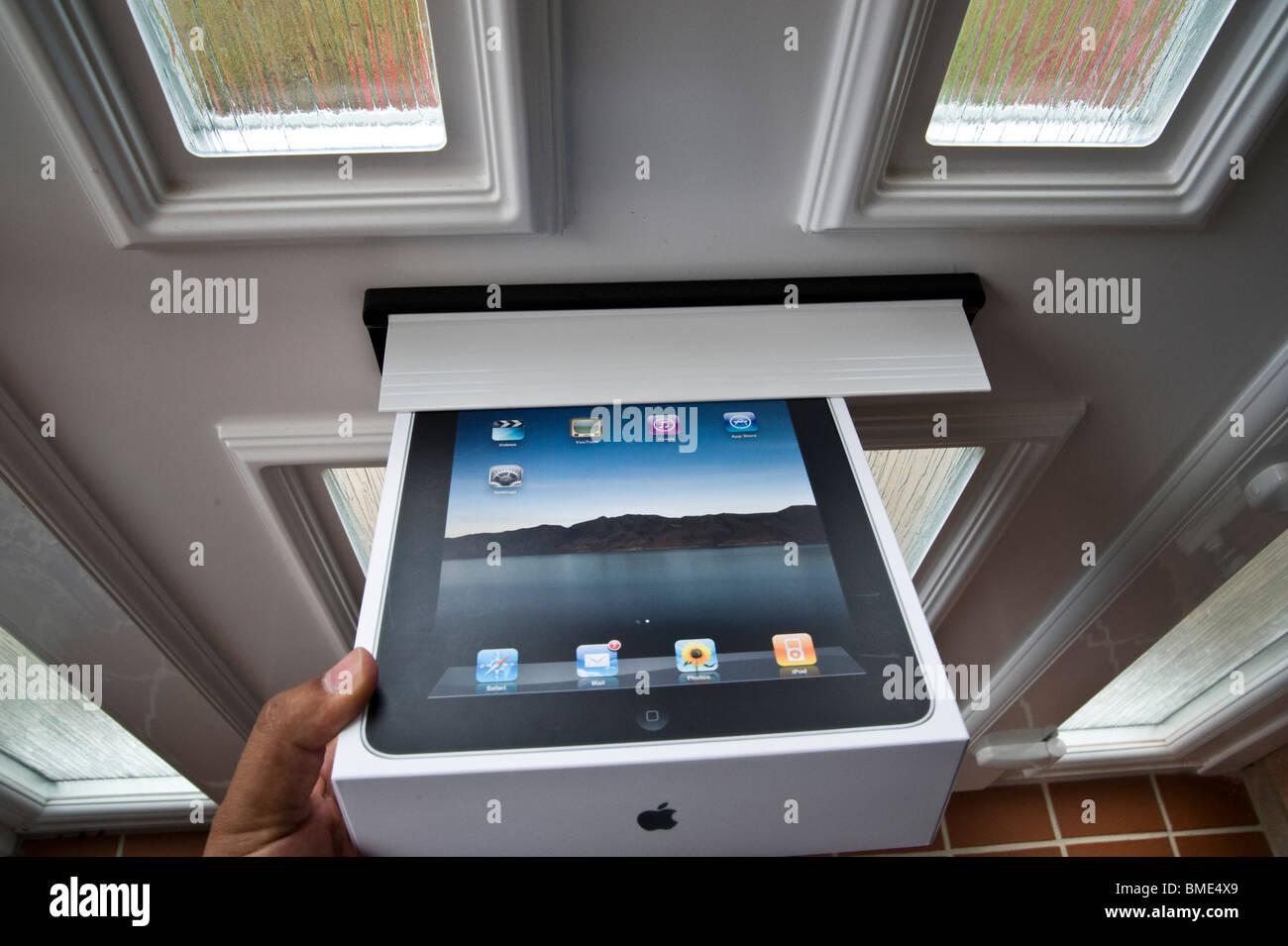 The long awaited Apple iPad is delivered by post. Stock Photo