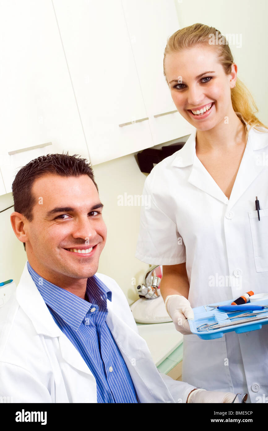friendly dentist and dental assistant - Stock Image