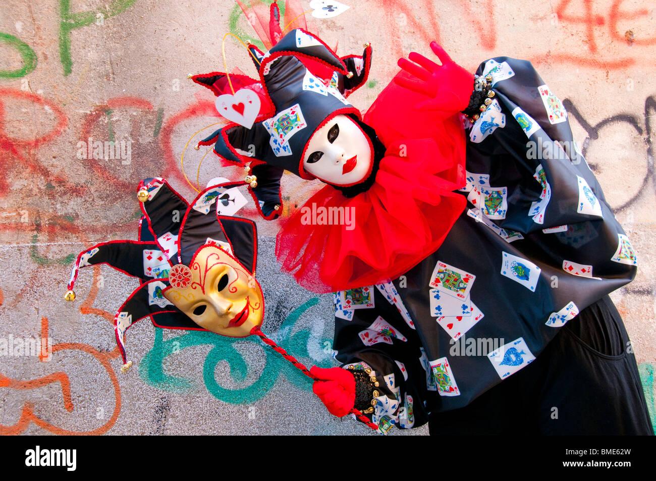 Venice Carnival, Italy, Costumed Jester joker participant Stock Photo