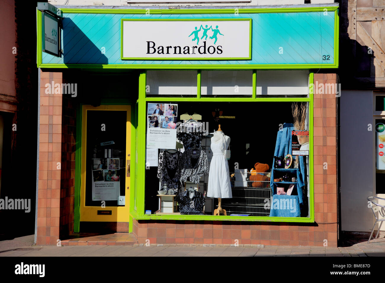 Front of the Barnado's charity shop in Market Drayton, Shropshire, raising funds to help children and young people - Stock Image
