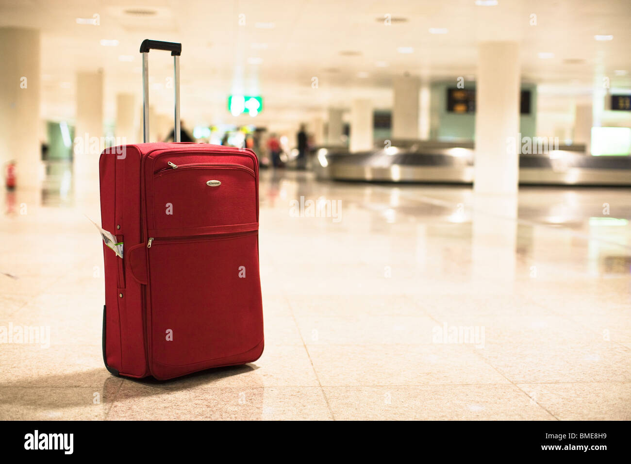 Suitcase at an airport - Stock Image