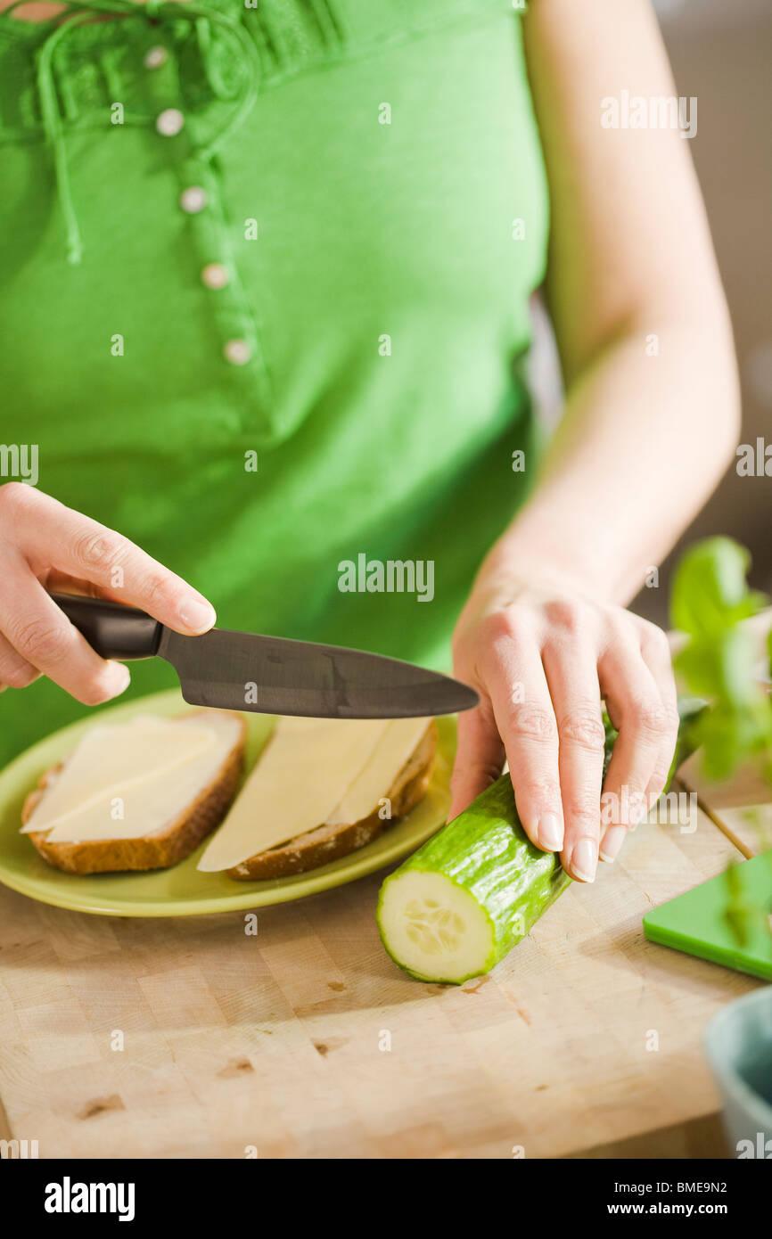 Woman preparing breakfast, Sweden. - Stock Image