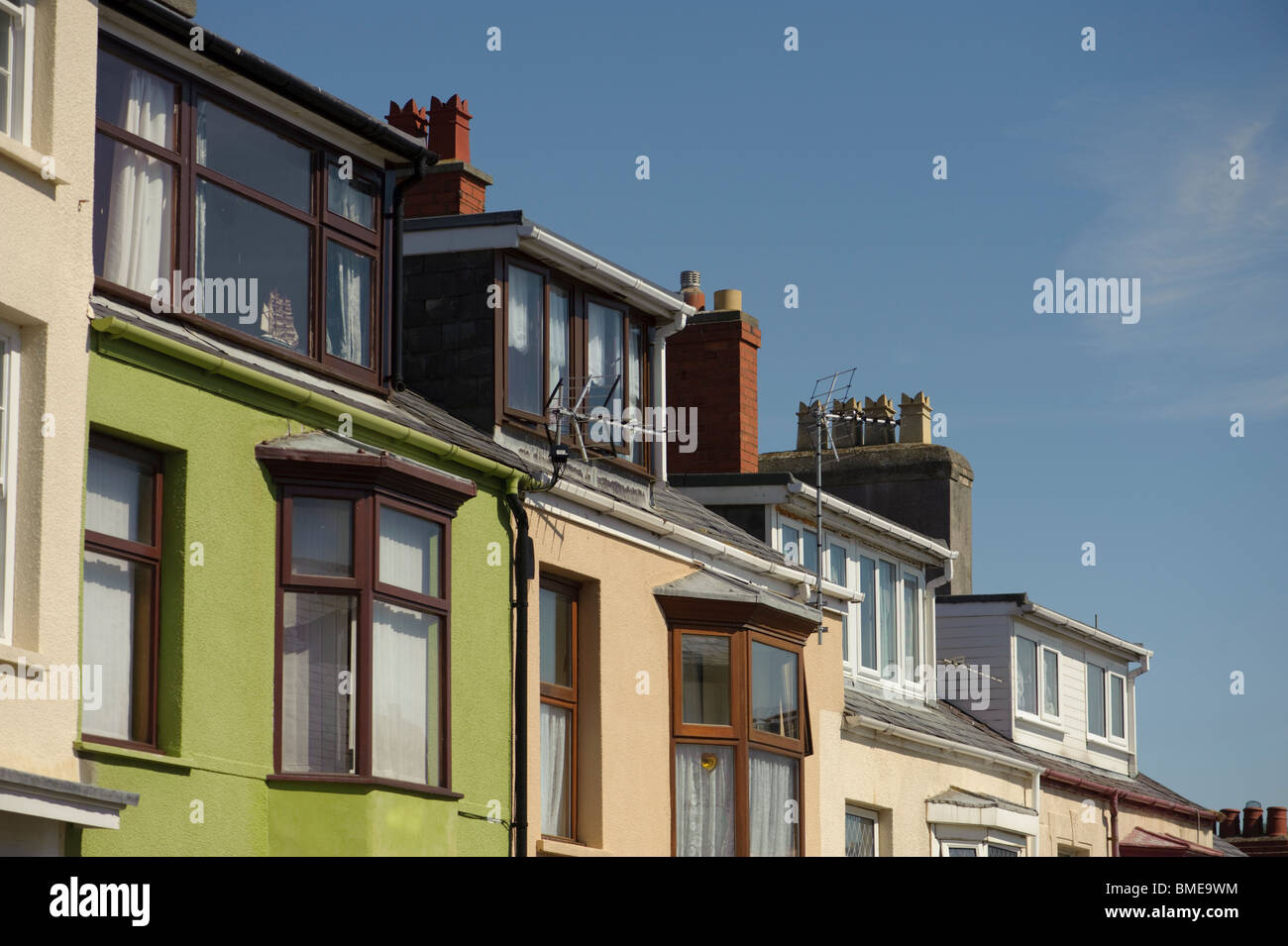 Loft conversions on a row of terraced houses, UK - Stock Image