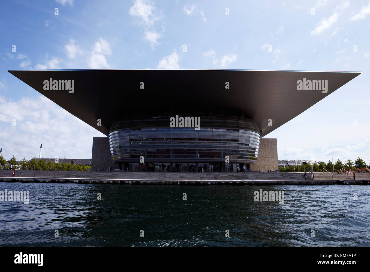 Modern opera house by riverside in Copenhagen. Stock Photo