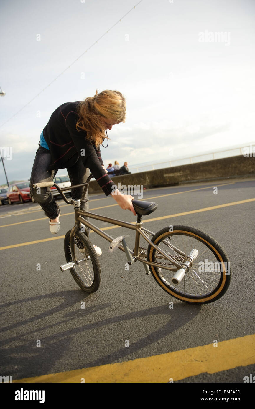 BMX flatland freestyle stunt rider young woman performing ...