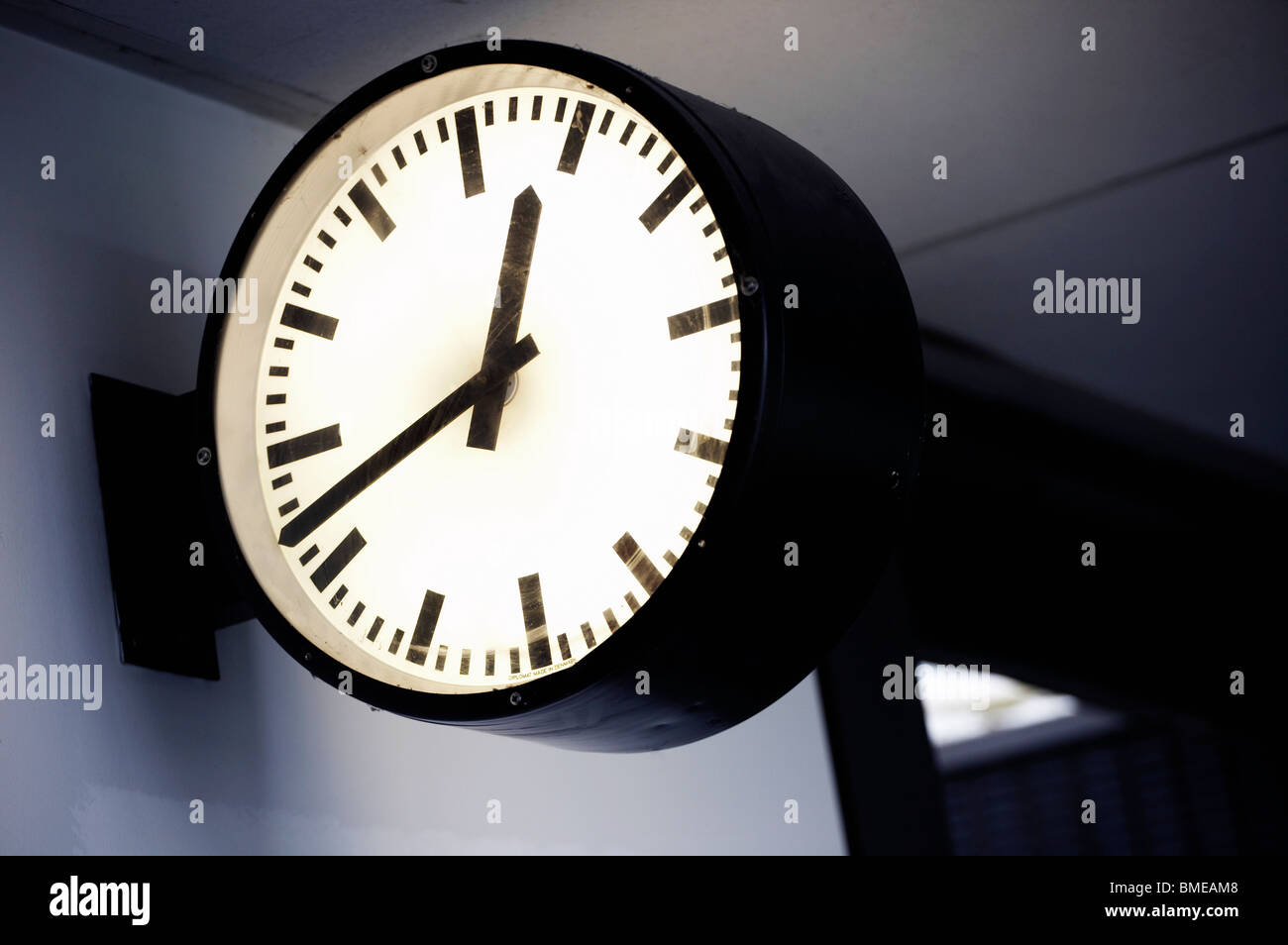 Close-up of clock at train station - Stock Image