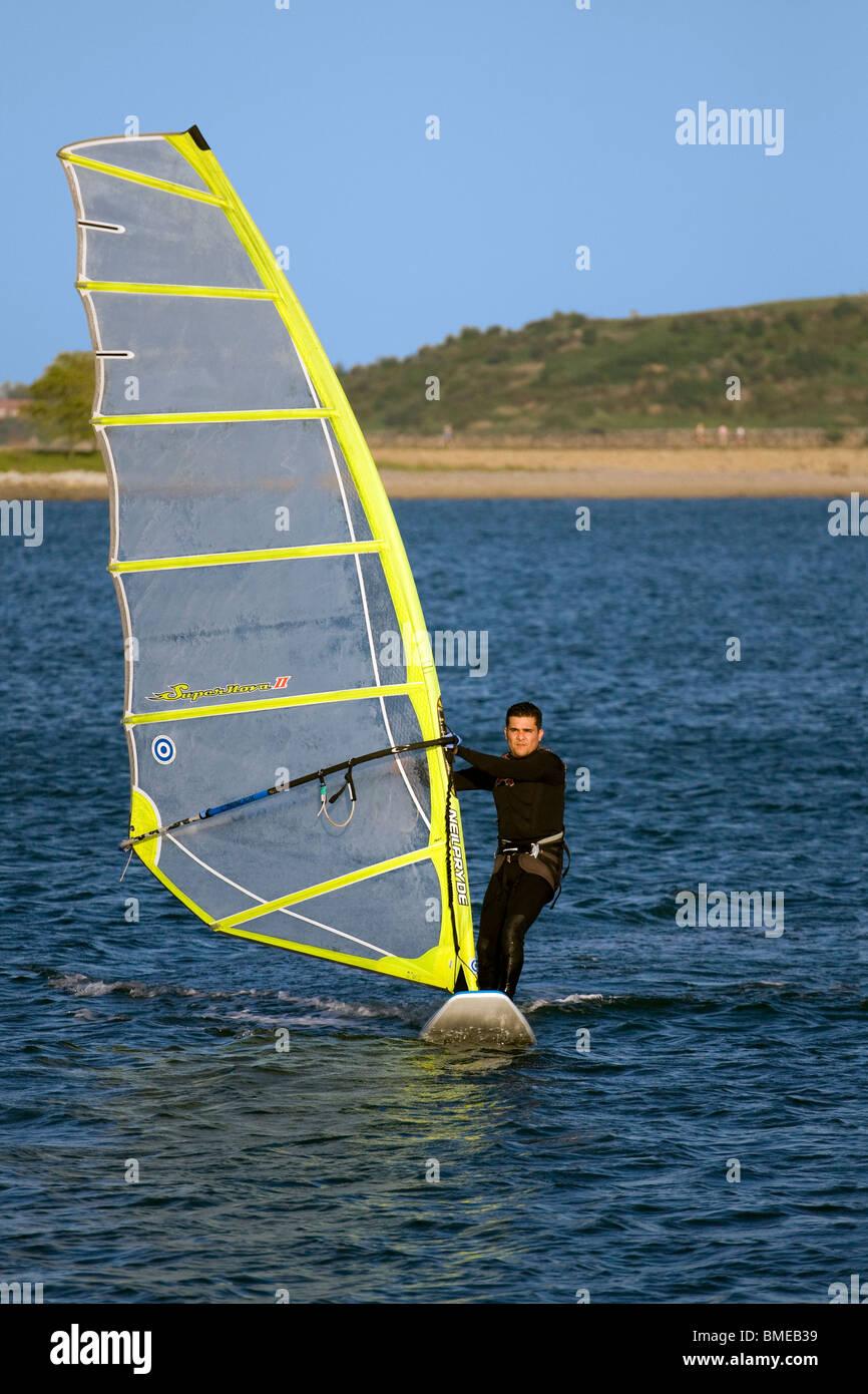 Riding A Sailboard Stock Photos & Riding A Sailboard Stock Images