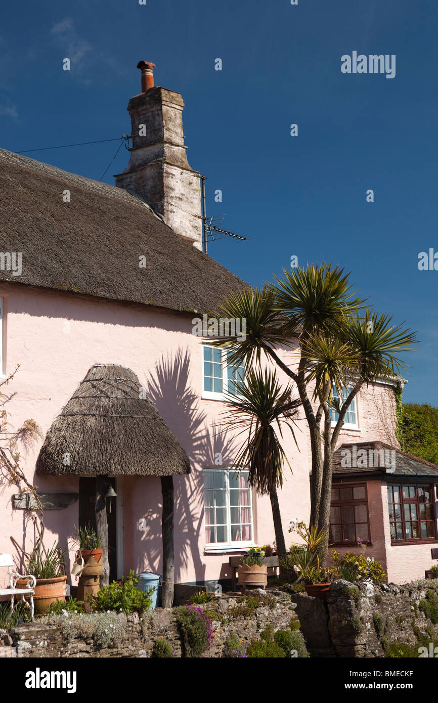 UK, England, Devon, Strete, idyllic pastel painted thatched cottage overlooking the sea - Stock Image