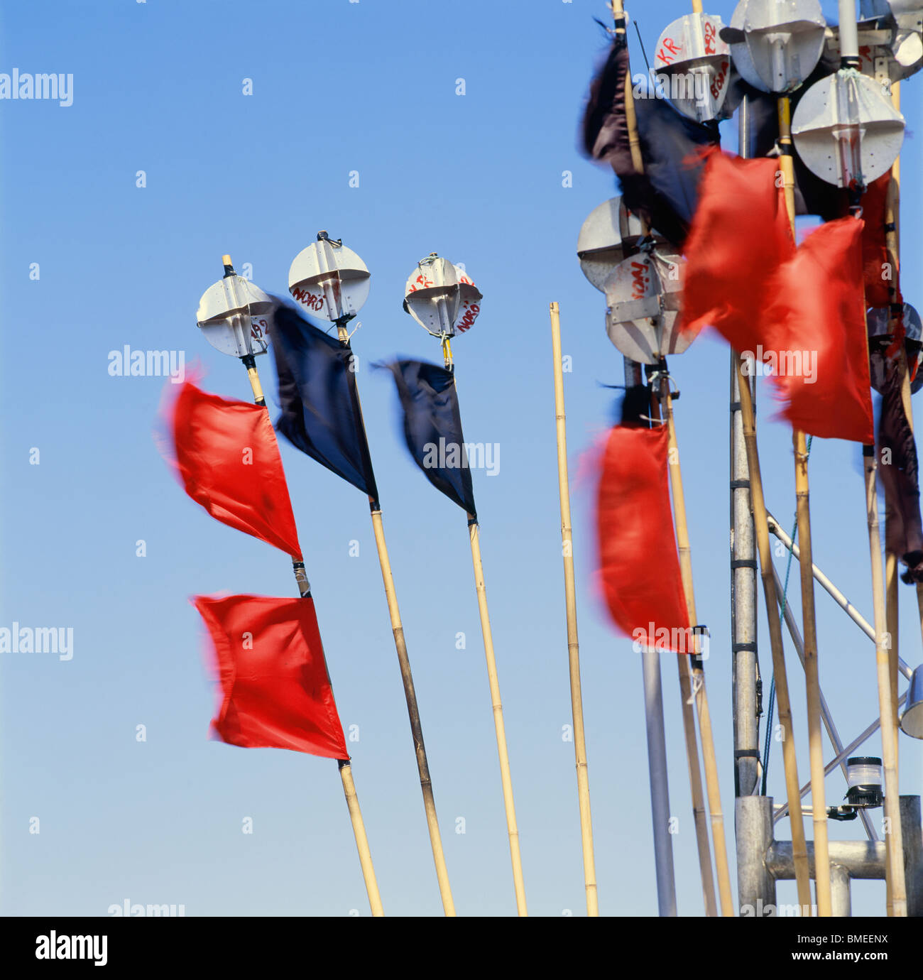 Poles with fishing flags - Stock Image