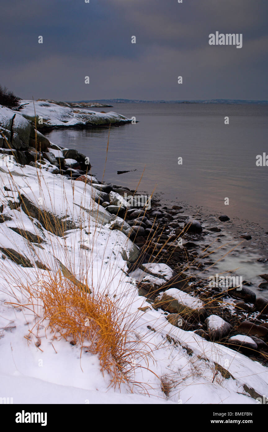 Scandinavia, Sweden, Vastkusten, View of sea in winter - Stock Image