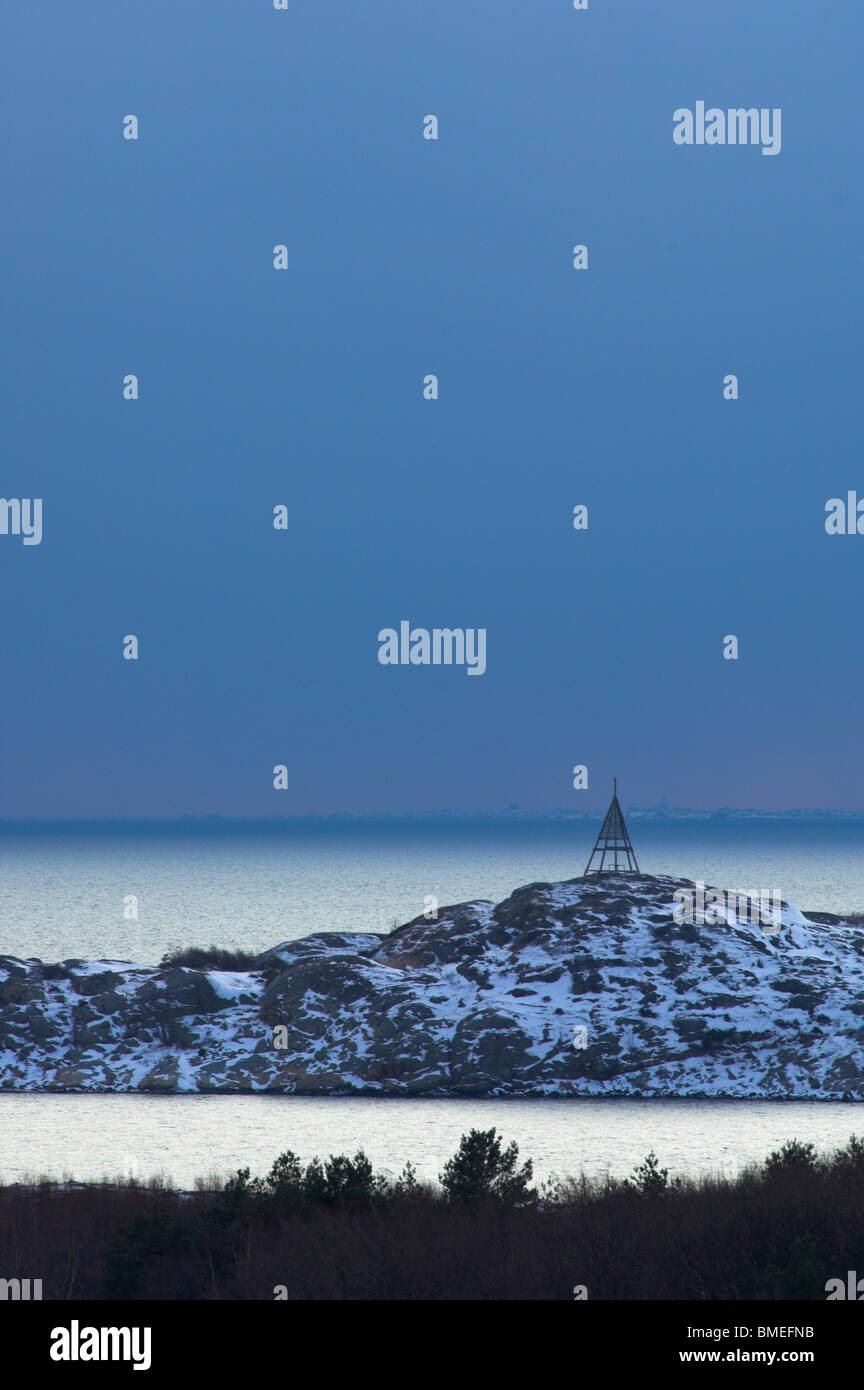 Scandinavia, Sweden, Vastkusten, View of navigational mark on rock - Stock Image