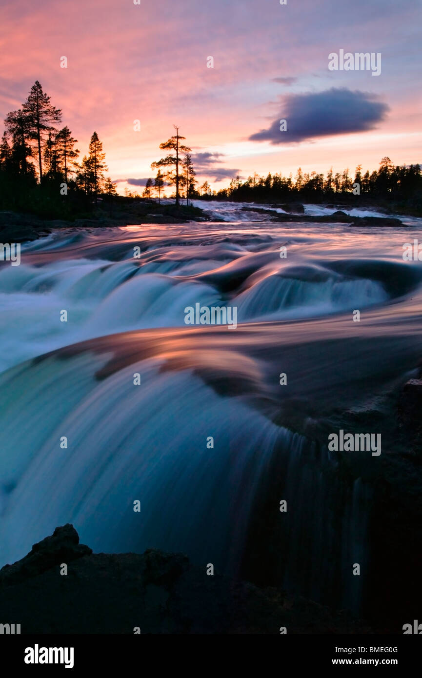 Scandinavia, Sweden, Lapland, View of waterfall at dawn - Stock Image