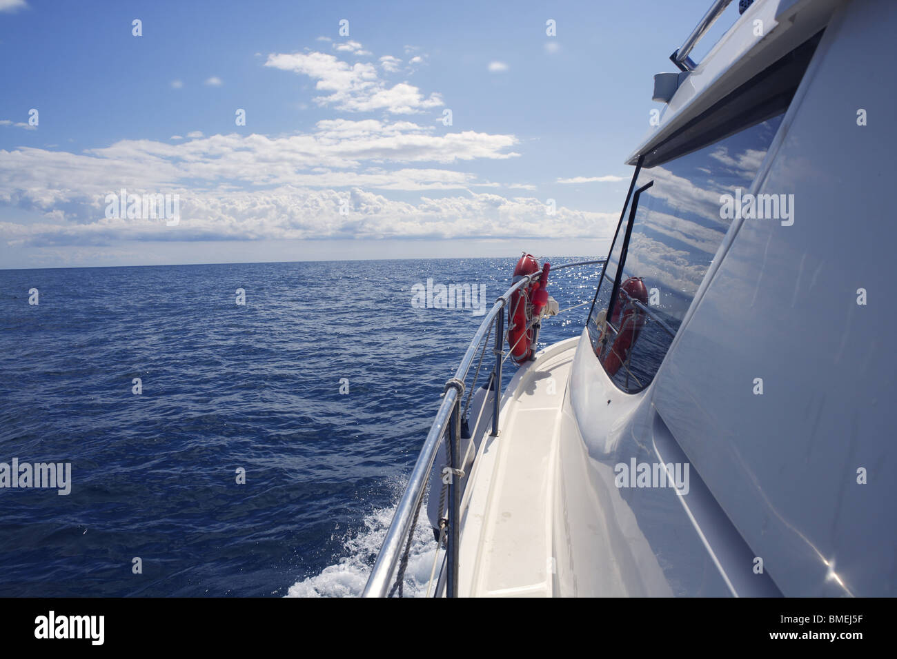 motorboat side view with ocean sea reflection on window glass - Stock Image
