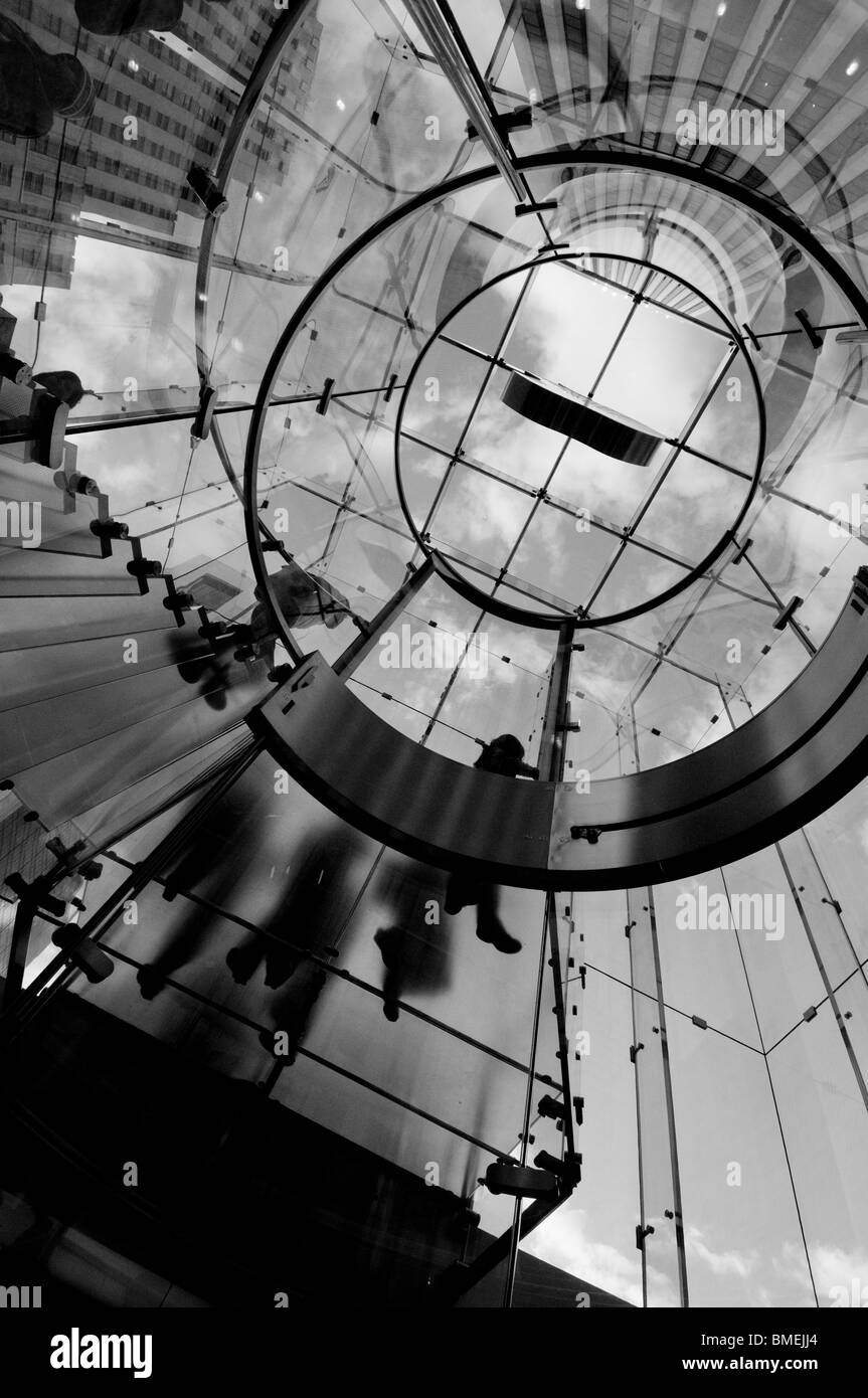 Underneath the clear glass staircase at the entrance of the Apple Store on 5th avenue in New York City, NY, USA. Stock Photo