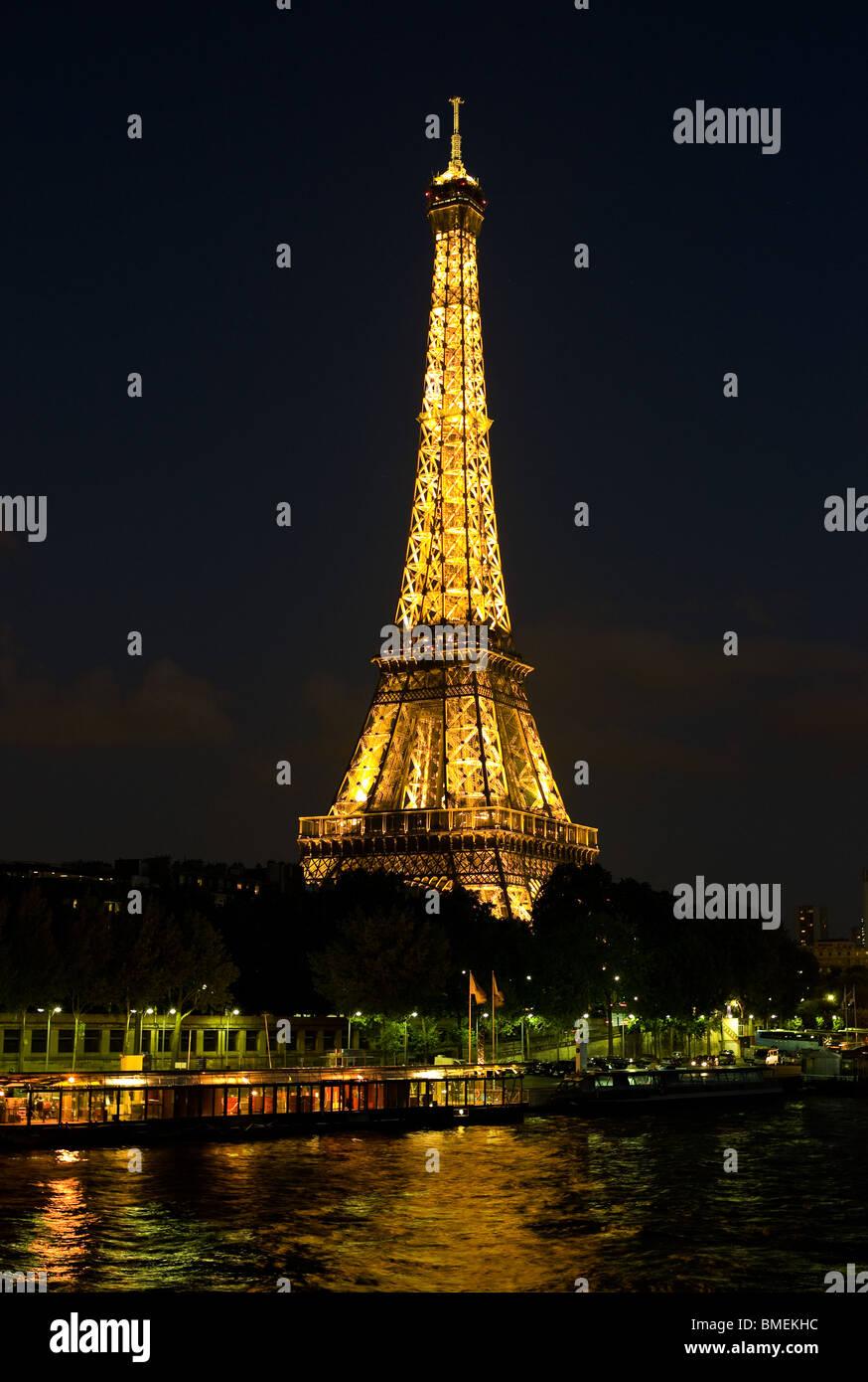EIFFEL TOWER AT NIGHT PARIS, FRANCE Stock Photo
