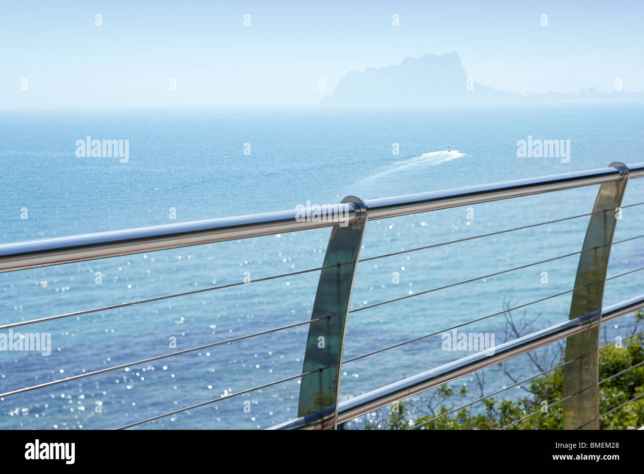 stainless steel balcony banister to mediterranean sea in moraira alicante spain - Stock Image
