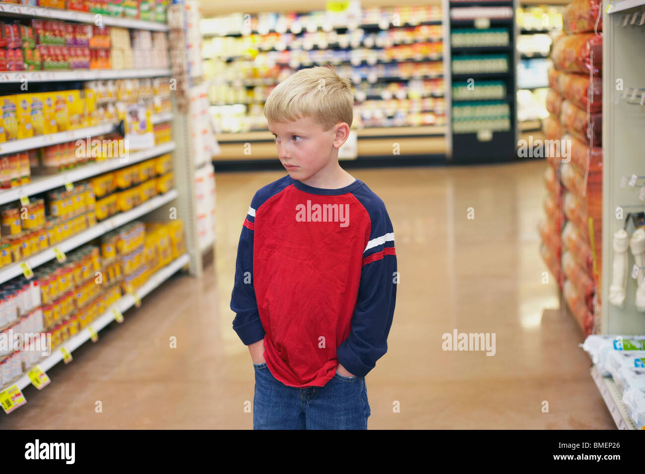A Boy In A Grocery Store - Stock Image
