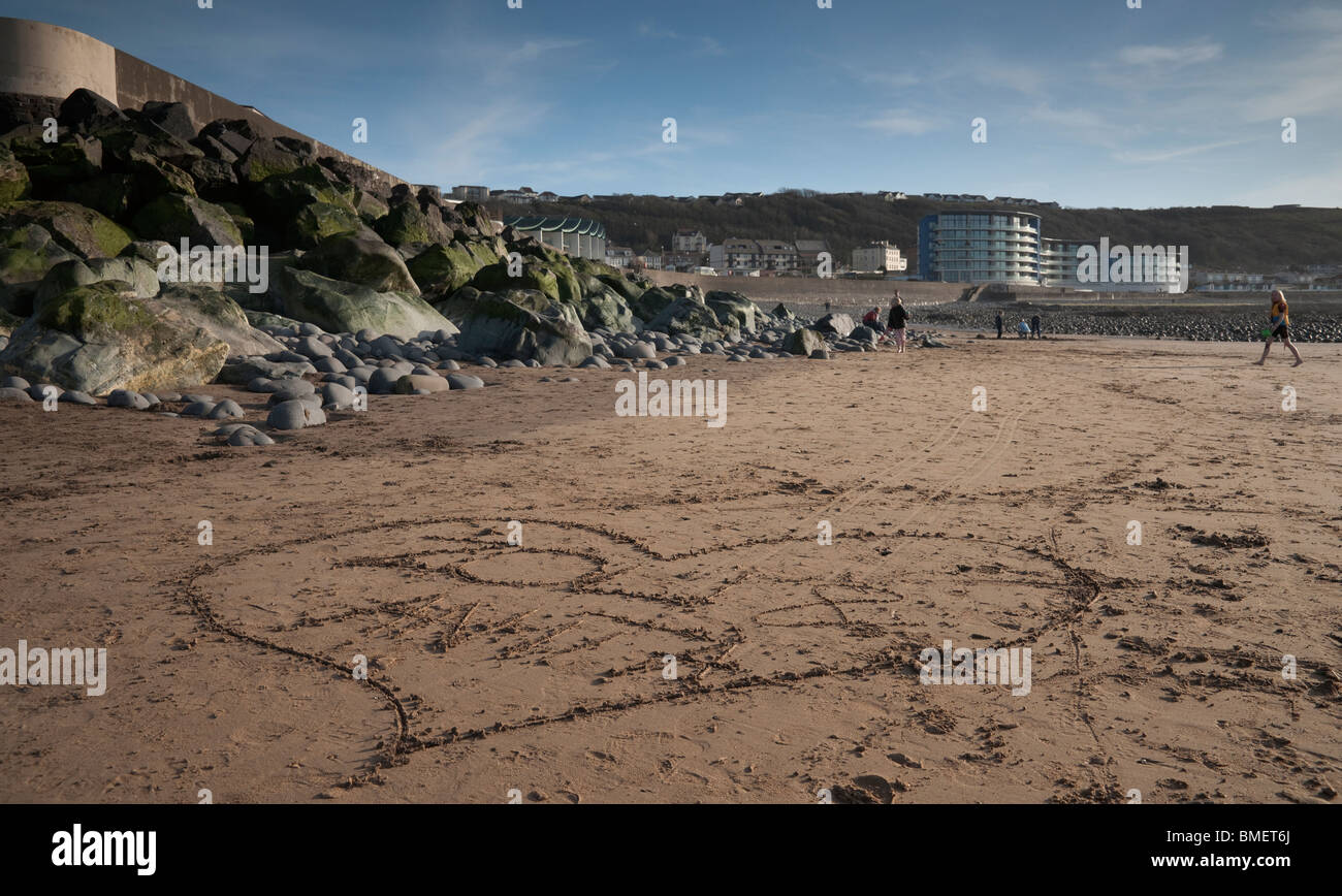 A love heart left in the sand at westward Ho beach. - Stock Image