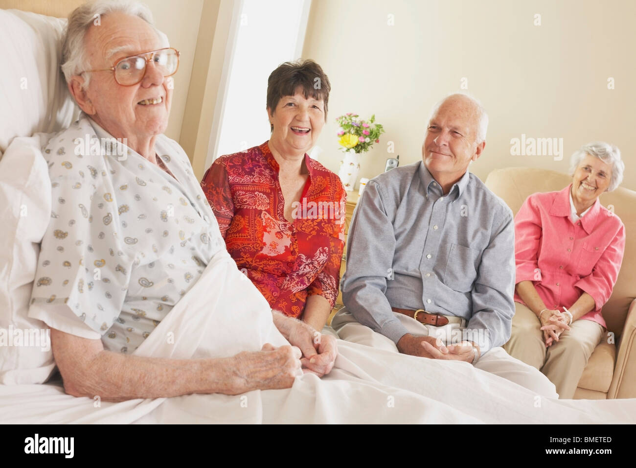 Visiting An Elderly Father In The Hospital - Stock Image
