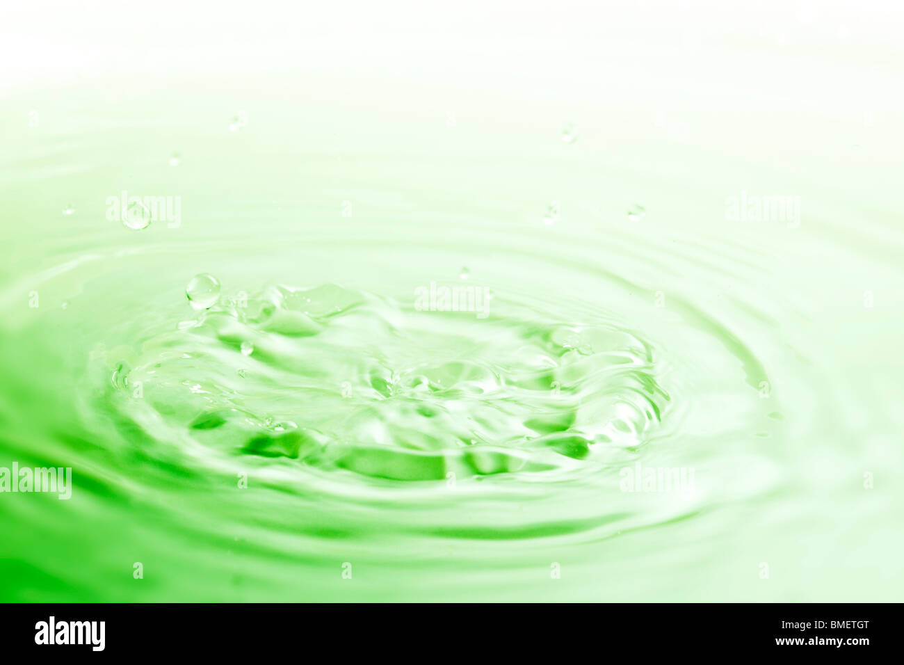 image of the pureness and the simplicity of a color water drop - Stock Image