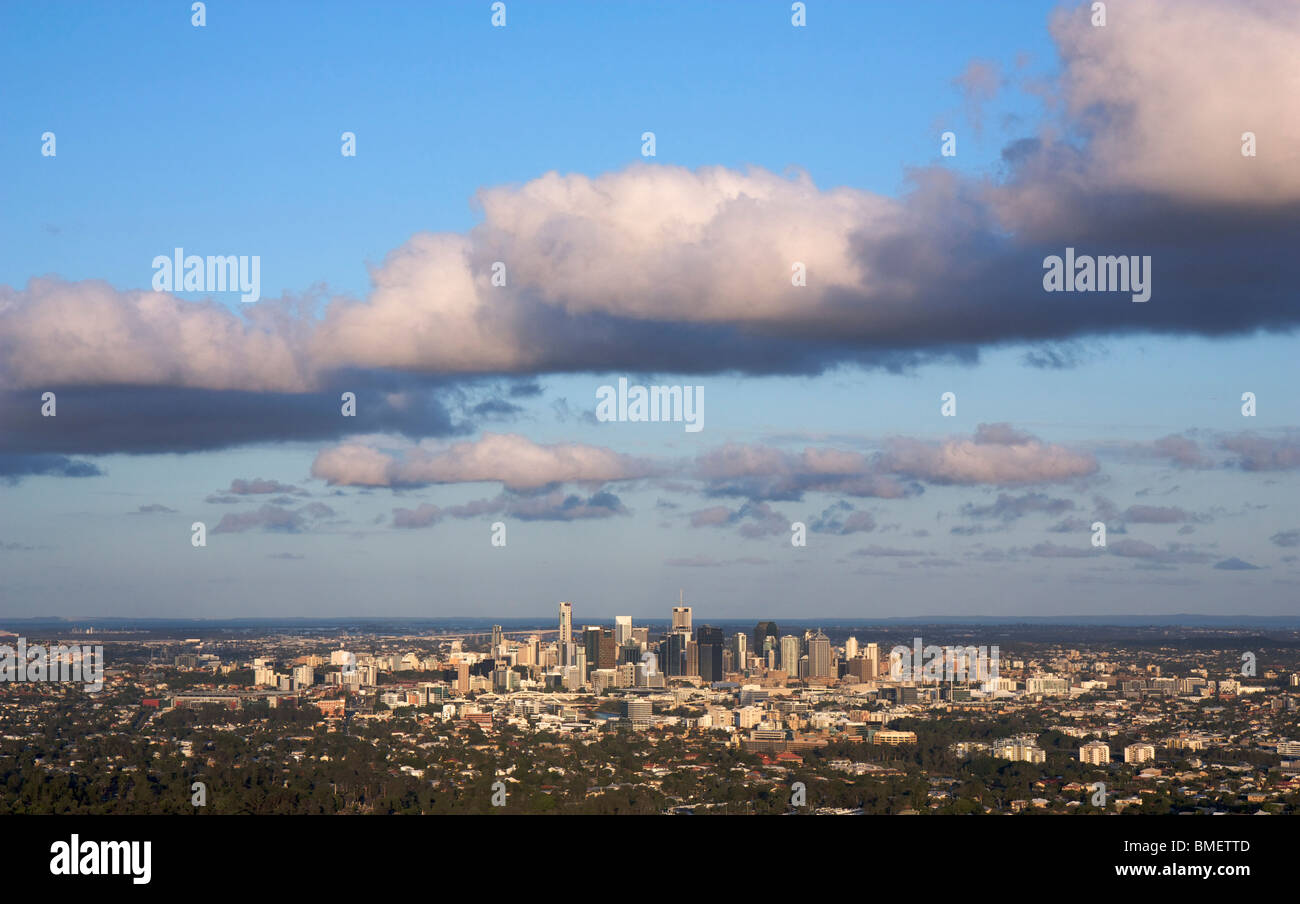 Panoramic views of Brisbane City taken from Mount Coot-tha Lookout in Queensland, Australia with large cloud formation - Stock Image