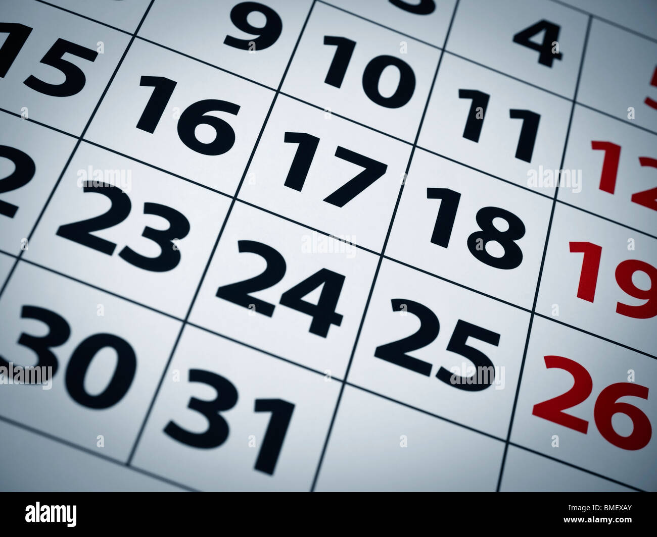 Close up of numbers on a calendar page. - Stock Image