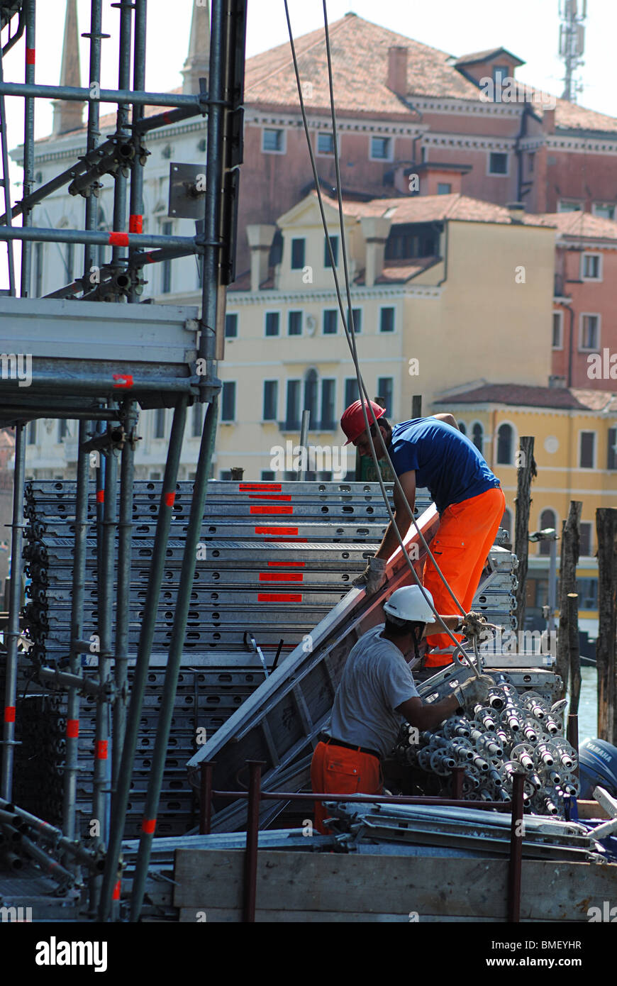 Builders working on a villa on the Grand Canal, Venice, Italy - Stock Image