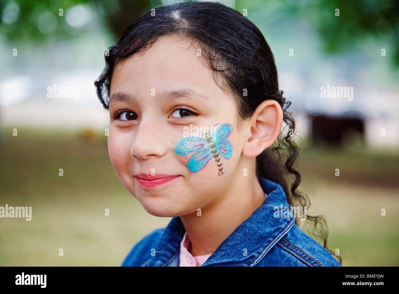 A Girl With A Butterfly Painted On Her Face - Stock Image